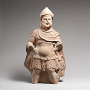 Limestone statue of a bearded warrior
