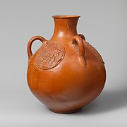 Three-handled jug with relief medallions