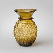 Glass jar with stylized grape decoration
