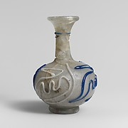Glass bottle with snake-thread decoration