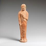 Terracotta statuette of a woman holding a bird