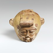 Faience aryballos (oil flask) in the form of a head wearing an animal skin