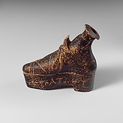 Terracotta perfume flask in the shape of a shoe