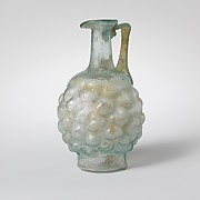 Glass jug in the form of a pine cone