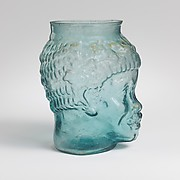 Glass cup in the form of the head of an African