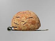 Bronze and amber fibula (safety pin)