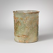 Glass beaker with inscription