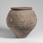 Terracotta jar with barbotine decoration