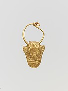 Gold pendant in the form of a bull's head