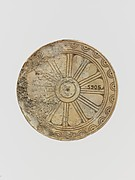 Ivory disk with rosette
