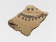 Terracotta vessel fragment with floral or marine motif