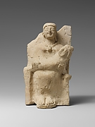 Limestone statuette of a nursing mother