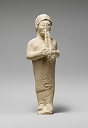 Limestone statuette of a flute-player