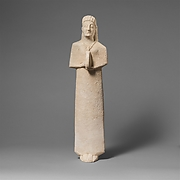 Limestone statuette of a female votary (worshipper) playing a tambourine