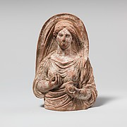 Terracotta mask of woman to hips