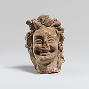 Terracotta head of a laughing satyr