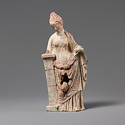 Terracotta statuette of a woman leaning on a pillar