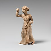 Terracotta statuette of a girl playing ball