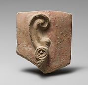 Stone votive relief of an ear with earring