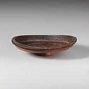 Shallow terracotta bowl