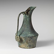 Bronze jug with handle attachment showing running youth