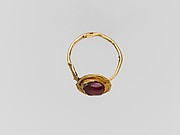 Gold ring with garnet ring stone