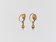 Pair of gold earrings with disc and pendant