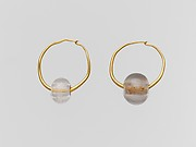 Gold earring with rock crystal bead