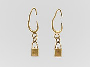 Pair of gold earrings with cage and ball pendants