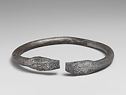 Pair of silver bracelets ending in snake's heads