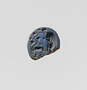 Opaque blue glass oval engraved gem