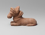 Terracotta figure of a kneeling horse