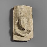 Stone votive relief of male genitalia