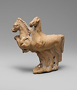 Fragmentary terracotta relief with two horses from a vase