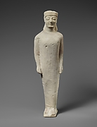 Limestone statuette of a beardless male votary in Greek dress