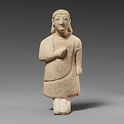 Limestone statuette of a male votary with a plain headdress