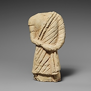 Fragment of a limestone statuette of a male votary