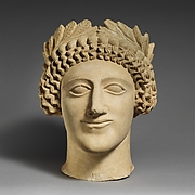 Limestone head of a youth with wreath