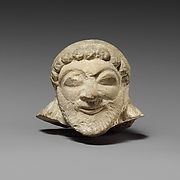 Limestone head of a silen (?)