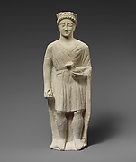 Limestone statuette of a beardless male votary holding a bird