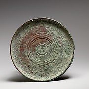 Part of a bronze box mirror