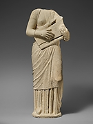Limestone statue of a female lyre player