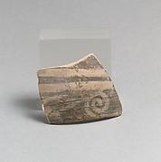 Terracotta rim fragment with running spiral
