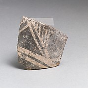 Terracotta rim from a cup with triangles and parallel vertical lines