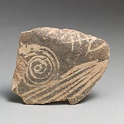 Terracotta vessel fragment with spiral and linear motifs