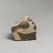 Terracotta vessel fragment with floral design