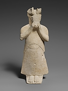 Limestone figure with mask