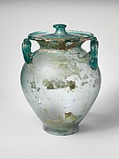 Glass cinerary urn with lid