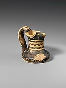 Miniature terracotta jug
