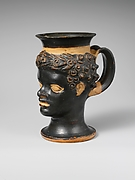 Terracotta mug in the form of a black African boy's head